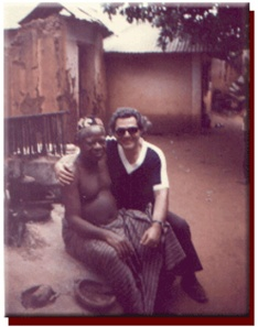 Matros sitting on fetish mound in 1975 with Village Chief in Town of Abomey, Dahomey.